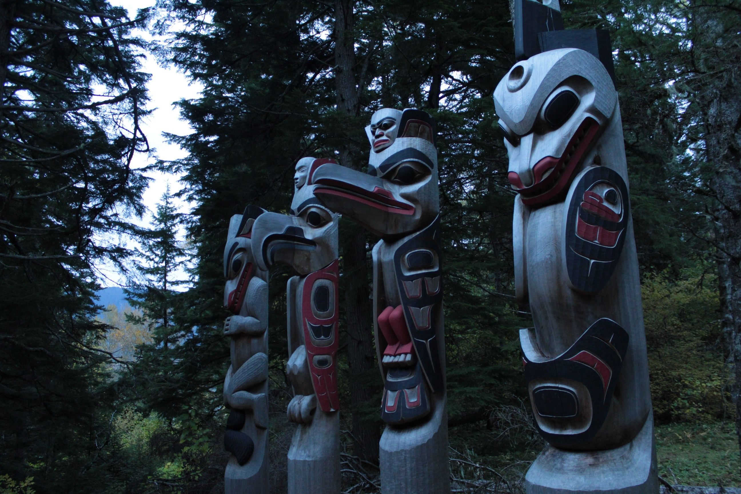 the totem poles watch over the forest and gitsaex village at
