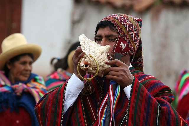 Photo of a Quechua man blowing into a shell.  Photo taken from a flickr site - peace-on-earth - taken on the 8th January, 2006