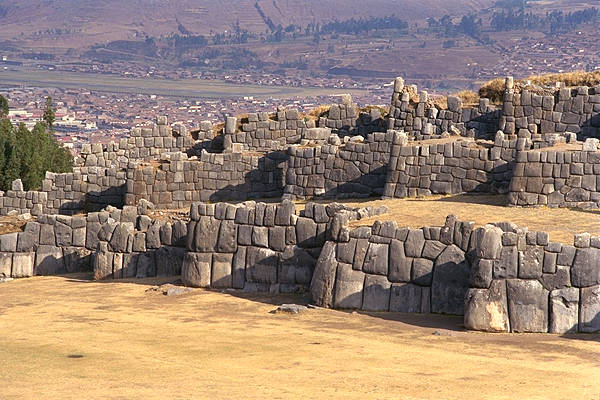 A view of the series of walls that characterize Saqsayhuaman.  Cusco is visible in the background.  This photo is from KimMacQuarrie.com - The Last Days of the Incas Peru Tour 11