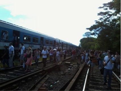 Passengers having to walk on the rails after a train stopped. Picture taken by a passenger. Contribution to the train group, evidence presented to the State.