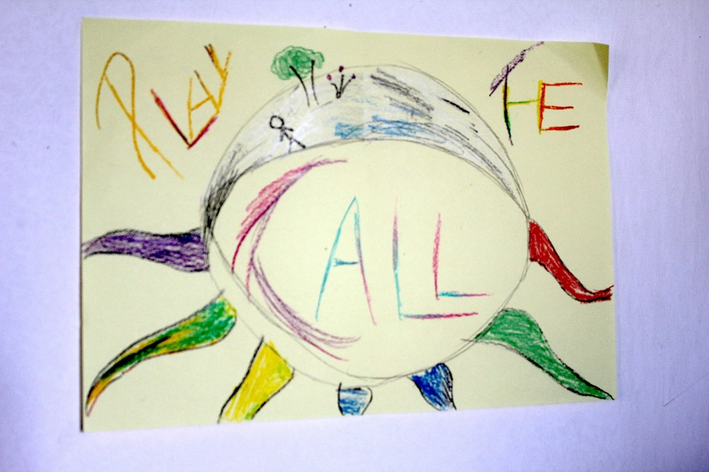 Hand-drawn poster, 'Play the Call', photo by Kelly
